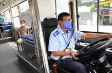 HCM City issues plan of transporting workers back after social distancing eases