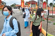 Malaysian students come back to school after six months