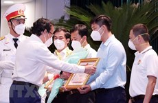 Collectives, individuals honoured for supporting COVID-19 fight in HCM City