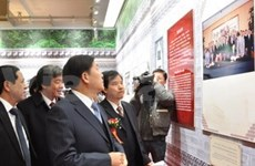 Photo exhibition marks 60th anniversary of VN-China ties