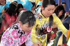 Vietnamese women determined to follow the Party