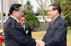 Party leader begins Laos visit