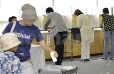Japan's ruling coalition loses in upper house election