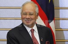 Malaysia, Indonesia agree to ease tension