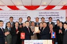 Laos determines to bring ties with VN to new height