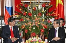 President promises closer relations with Laos