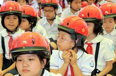 Promoting action on child helmet use