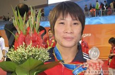 Wrestler Lua qualifies for 2012 Olympics