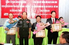Telecom staff receive Lao friendship medal