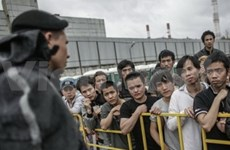 Illegal Vietnamese migrants return home