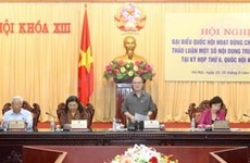 Full-time deputies discuss draft amended Constitution, land law
