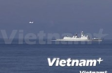 Three Chinese aircraft operate over oil rig site