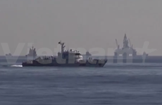 China increases military ship presence in illegal rig's vicinity