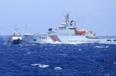 Chinese fleet bully Vietnam's ships near illegal rig