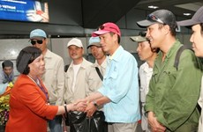 More Vietnamese workers return home from Libya