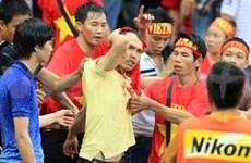 Malaysia slams fan violence