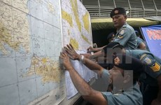 Second day of search produces no sign of missing AirAsia flight
