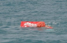 AirAsia aircraft's tail lifted from sea
