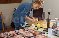 Artist at home with local faces