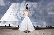 Vietnamese model's show set against solar backdrop