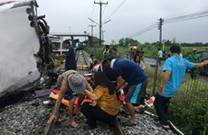 At least 17 killed in bus-train collision in Thailand