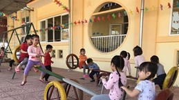 Children enjoy toys made of old tyres in Hai Duong