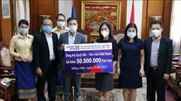 Vietnamese overseas in Laos contribute to COVID-19 vaccine fund