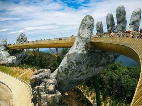 Walking high above on Golden Bridge in Da Nang city