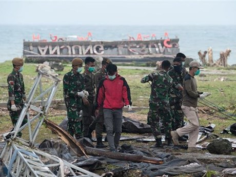 Indonesian rescuers use drones as tsunami death toll rises