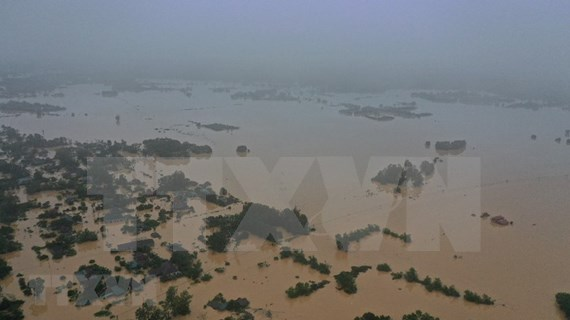 Record flooding kills 84 in central region