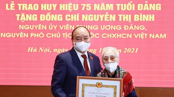 Former vice president honoured with 75-year Party membership badge