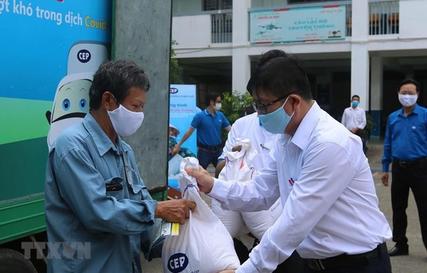 Immediate action required to deliver aid to pandemic-hit people hinh anh 1