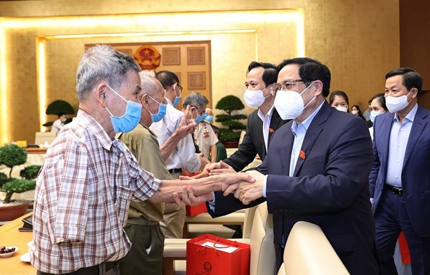 Political system, people join hands in caring for revolution contributors hinh anh 1