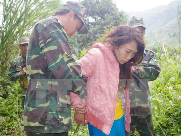 Vietnamese, Lao, Thai localities cooperate to fight human trafficking hinh anh 1