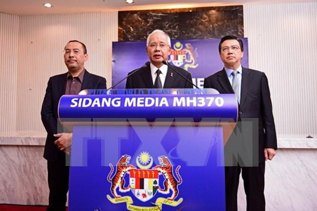 Malaysia confirms MH370 debris discovery hinh anh 1