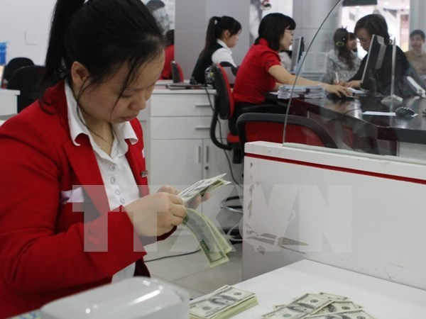 Central bank widens VND/USD trading band hinh anh 1