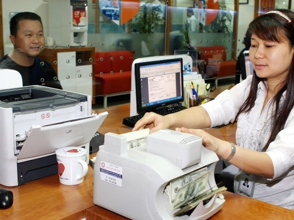 State Bank explains exchange rate adjustments hinh anh 1