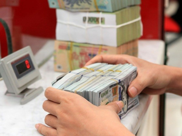SBV's move on USD interest rate eases pressure on market hinh anh 1