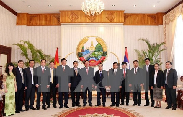 Lao leader lauds procuracy cooperation with Vietnam hinh anh 1