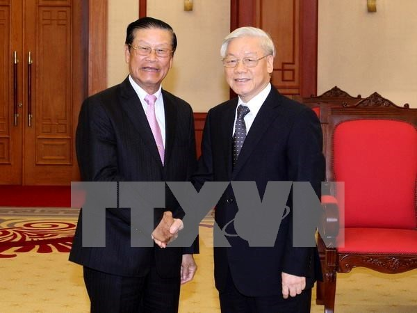 Leaders welcome Lao guests hinh anh 1