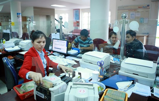 Mergers, acquisitions important move in restructuring banking system hinh anh 1