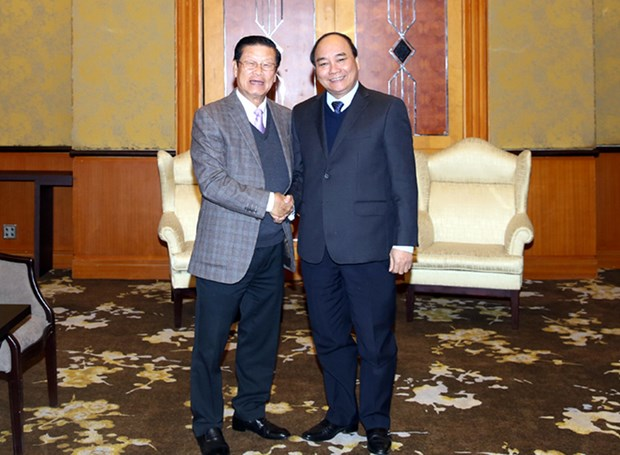 Vietnam, Laos work on measures for 2016-2020 cooperation hinh anh 1