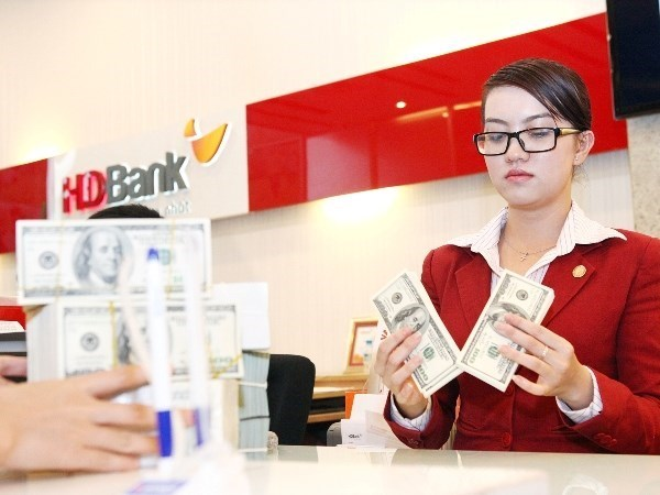 State Bank adjusts USD exchange rate hinh anh 1