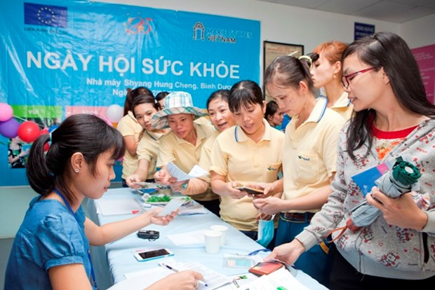 Female guest workers in Binh Duong, Dong Nai better cared for hinh anh 1
