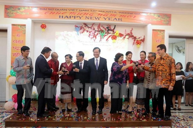 Expatriates celebrate traditional Lunar New Year hinh anh 1