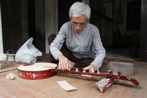 Dao Xa village craftsman helps preserve folk music hinh anh 1