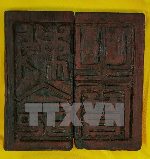 Tran dynasty wooden seal debated hinh anh 1