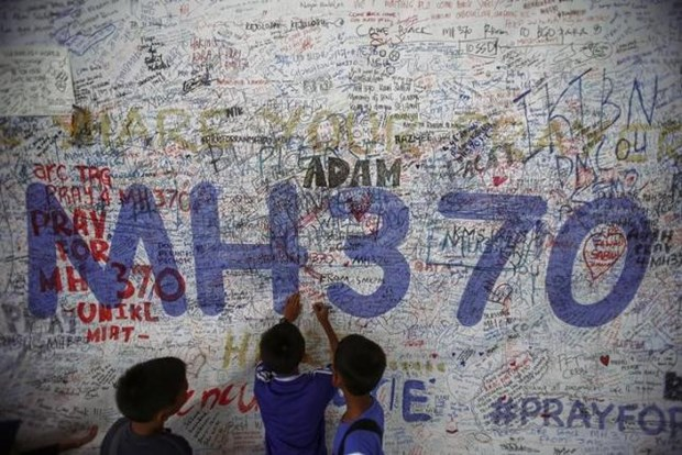 No answers in interim report on missing MH370 hinh anh 1