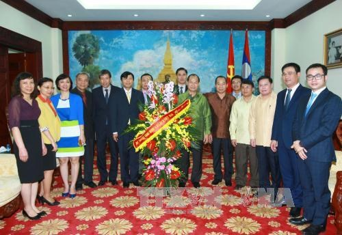 Foreign Ministry wishes Lao Embassy happy traditional New Year hinh anh 1