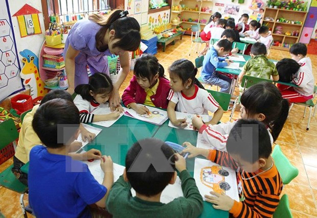 Enterprises urged to help protect rights of children hinh anh 1
